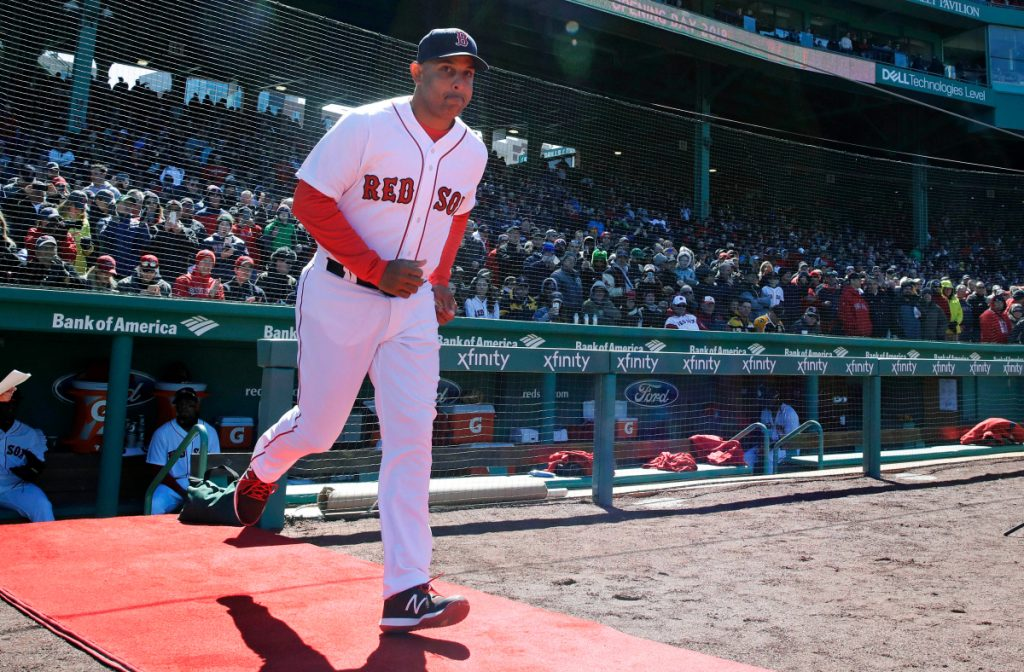 Red Sox manager Alex Cora runs onto the field as he is introduced during ceremonies before Boston's home opener on April 5 at Fenway Park. (AP Photo/Charles Krupa)