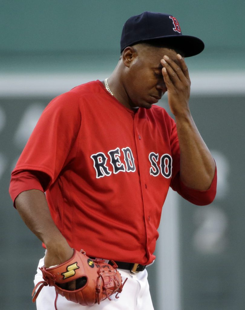 Pitcher Roenis Elias reacts during the first inning of a game against the Seattle Mariners at Fenway Park in June 2016. (AP Photo/Elise Amendola)