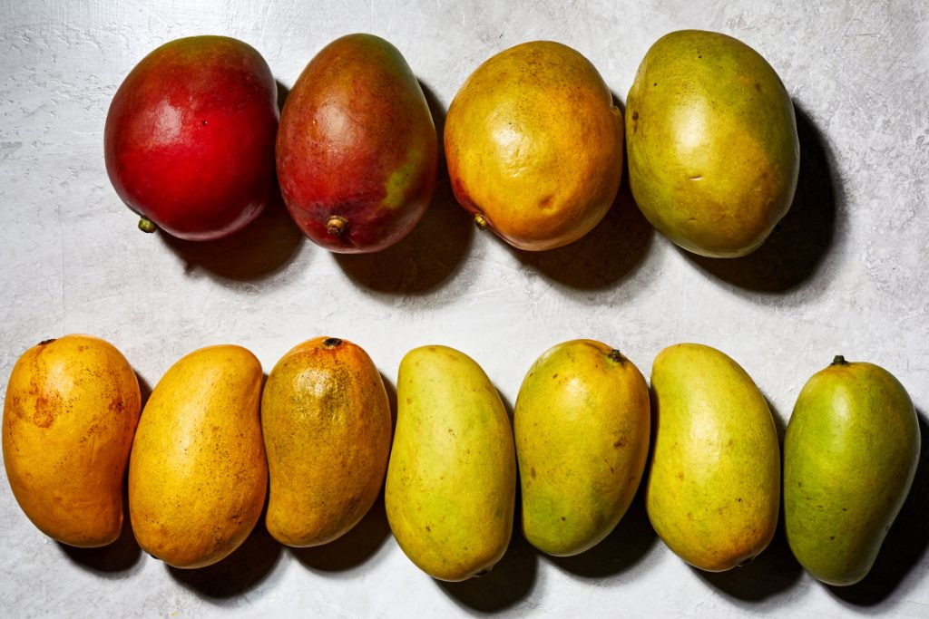 The average grocery store will most often carry one or two types of mangos: a Tommy Atkins, which has green skin that is often tinted with a little to a lot of red or an ataulfo, which are yellow or green and tend to be sweeter.