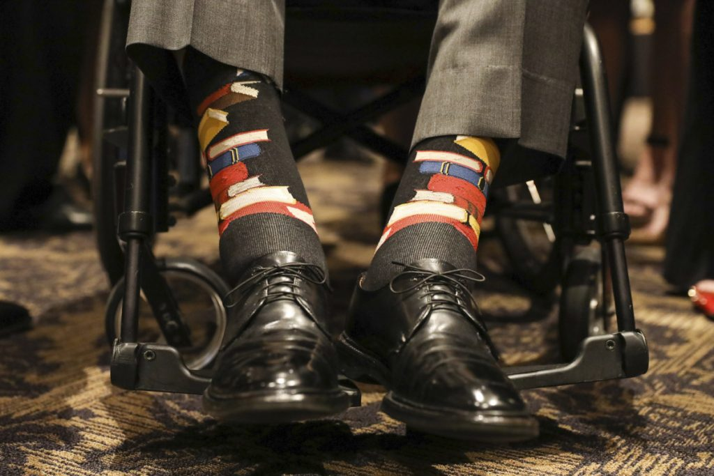 Former President George H.W. Bush wore socks designed as a tribute to his wife, Barbara Bush, during her funeral service in Houston on Saturday. Barbara Bush was known for bringing awareness to AIDS patients and for her work promoting literacy, which her husband subtly honored by wearing socks printed with blue, red and yellow books.