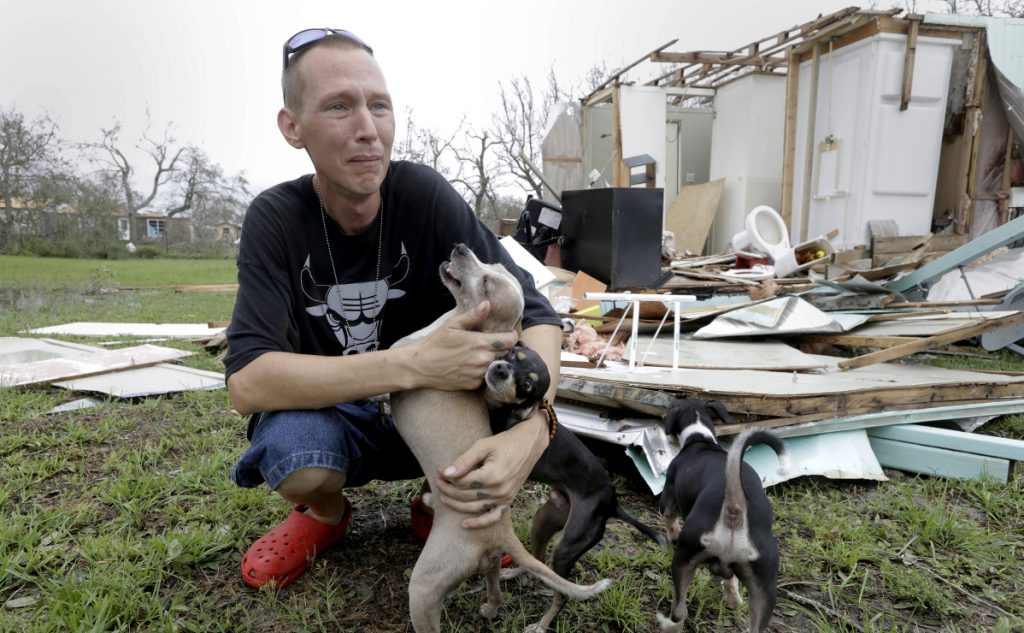 Sam Speights tries to hold back tears while surveying the damage to his home after Hurricane Harvey struck Rockport, Texas, last September. He had to move to other shelter.