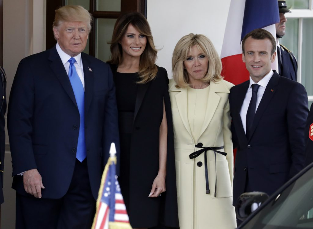 President Trump and first lady Melania Trump greet French President Emmanuel Macron and his wife, Brigitte Macron, Monday at the White House in Washington.