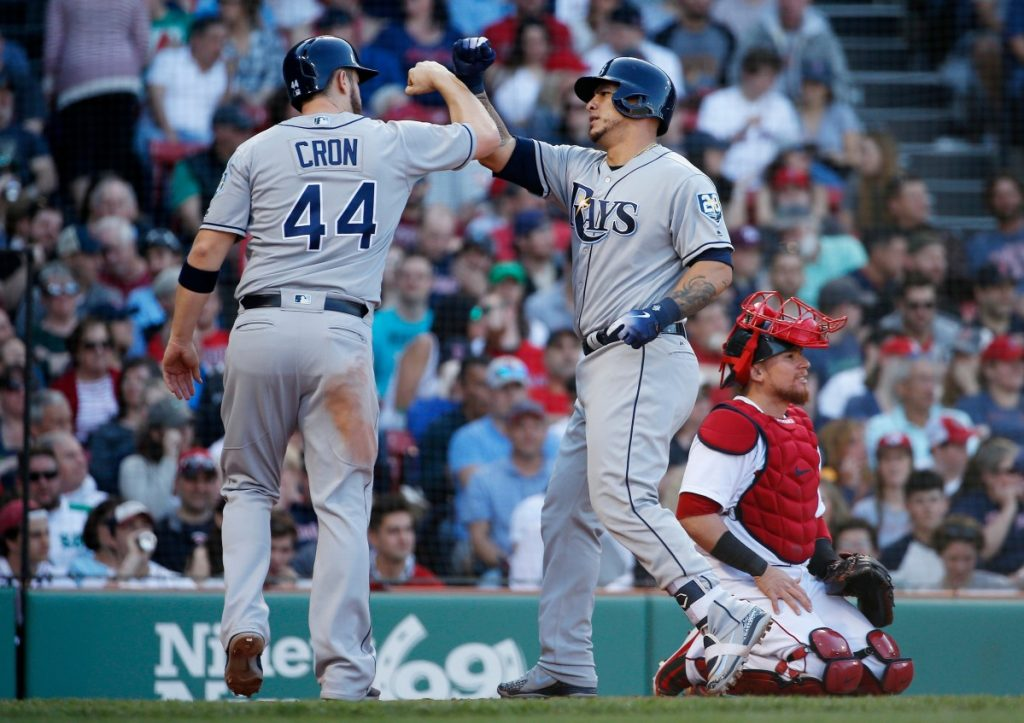 Tampa Bay's Wilson Ramos, center, celebrates his two-run homer with C.J. Cron as Boston's Christian Vazquez kneels behind home plate in the third inning of the Rays' 12-6 win Saturday in Boston.