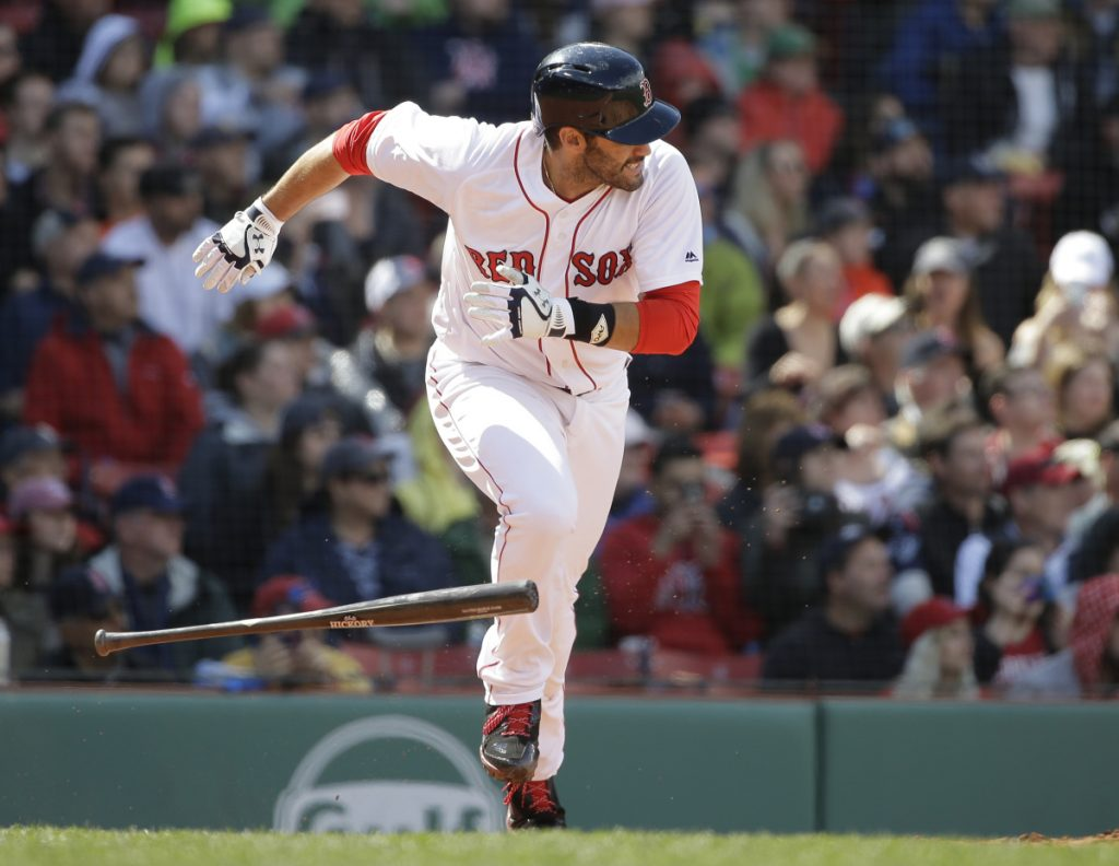 Boston's J.D. Martinez runs to first after hitting a two-run single in the sixth inning of the Red Sox' 4-3 win over Tampa Bay on Sunday in Boston.