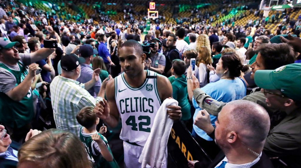 Boston forward Al Horford wades through a crowd of support at TD Garden after the Celtics defeated the Milwaukee Bucks in Game 7 of their first-round playoff series on Saturday night. (AP Photo/Charles Krupa)