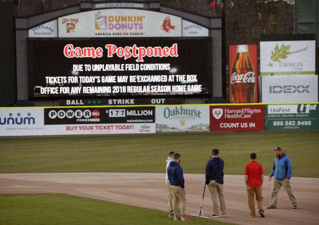 PORTLAND, ME - APRIL 30: The grounds crew looks over the infield shortly after the Portland Sea Dogs postponed their game Monday, April 30, 2018. (Staff photo by Shawn Patrick Ouellette/Staff Photographer)