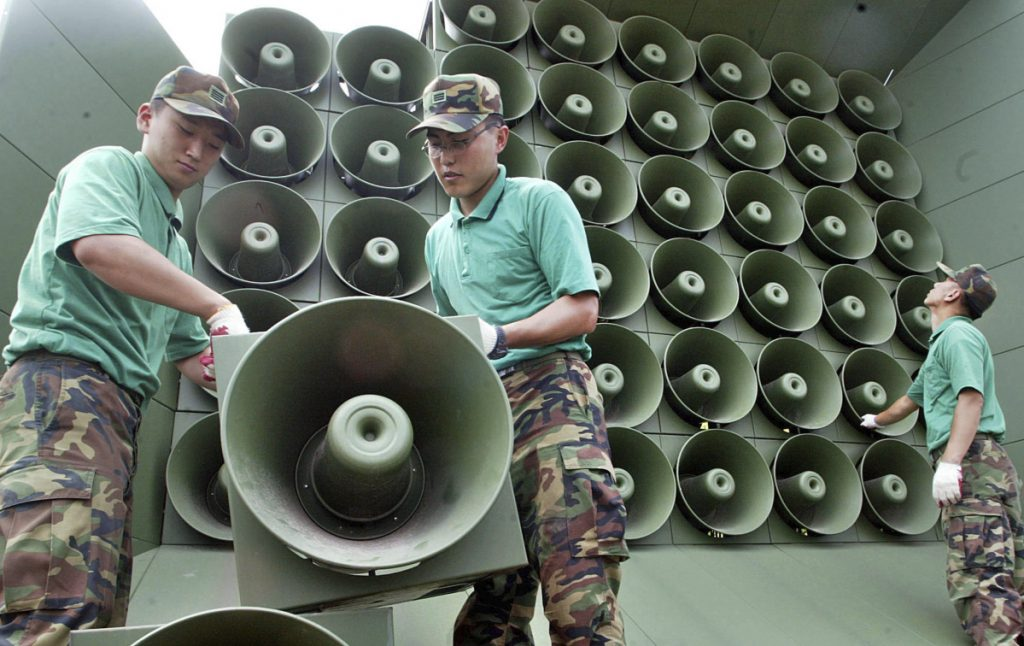 South Korean army soldiers remove loudspeakers used for propaganda broadcasts near the Demilitarized Zone between South and North Korea in Paju, South Korea.