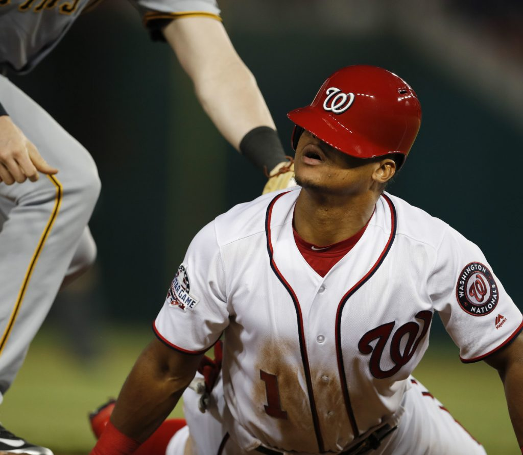 Wilmer Difo of the Washington Nationals looks up Monday night after sliding back into third base on a failed pickoff attempt by the Pittsburgh Pirates in the fourth inning. Washington came away with a 3-2 victory at home.