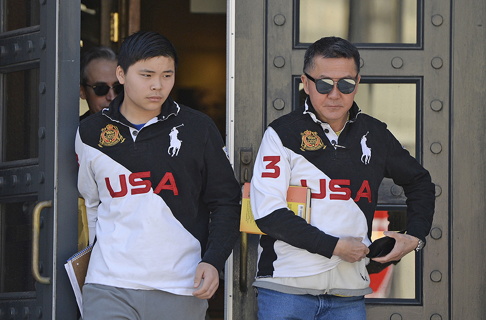 Princehoward Yee and his father, Howard Yee, leave the federal courthouse in Portland on Wednesday. Howard Yee sued Deering High School Principal Gregg Palmer over Palmer's decision to not let Princehoward play baseball.