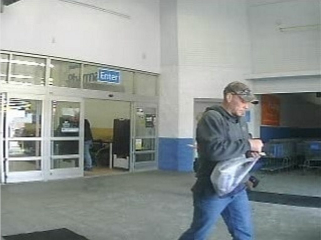 A Walmart a security camera photo shows a man suspected of stealing a phone from a home in China and trying to return to it the Augusta store.