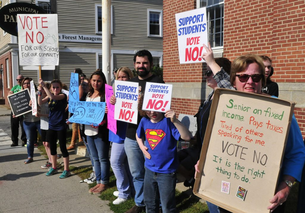 The budget process is underway in RSU 9 that includes 10 towns in Franklin County. Last year the budget was voted on in referendum three times before it passed on the fourth try. Students, parents and residents, including Julia Hennessy, right, turned out on Main Street in Farmington to urge voters to vote on Monday, September 11, 2017.