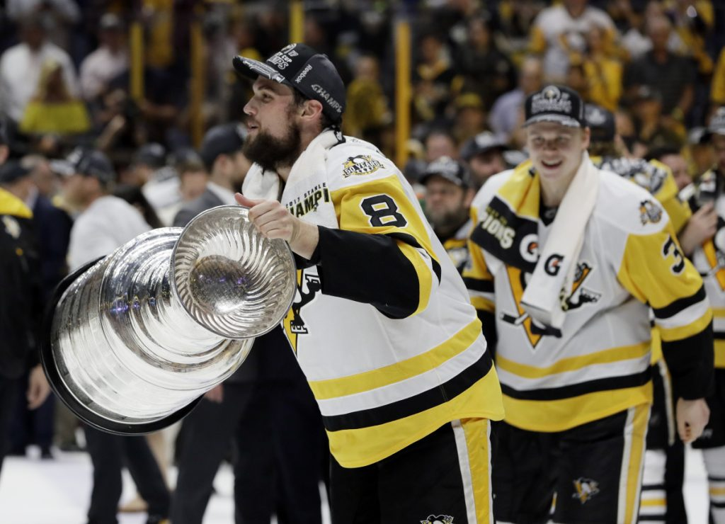 Pittsburgh Penguins defenseman and Biddeford native Brian Dumoulin (8) celebrates with the Stanley Cup after the Penguins defeated the Nashville Predators 2-0 in Game 6 of the hockey Stanley Cup Finals last June in Nashville. The Stanley Cup Playoffs is the most exciting tournament in sports, Travis Lazarczyk writes.