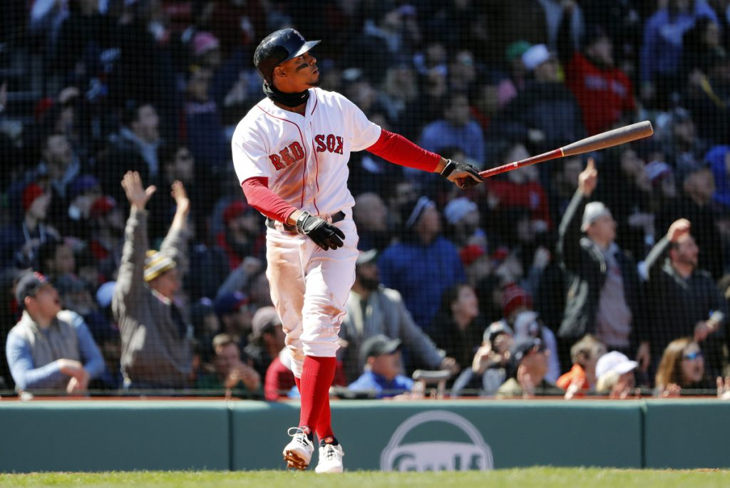 Boston Red Sox shortstop Xander Bogaerts watches his grand slam during the second inning against the Tampa Bay Rays on Saturday at Fenway Park in Boston. The Red Sox won 10-3.
