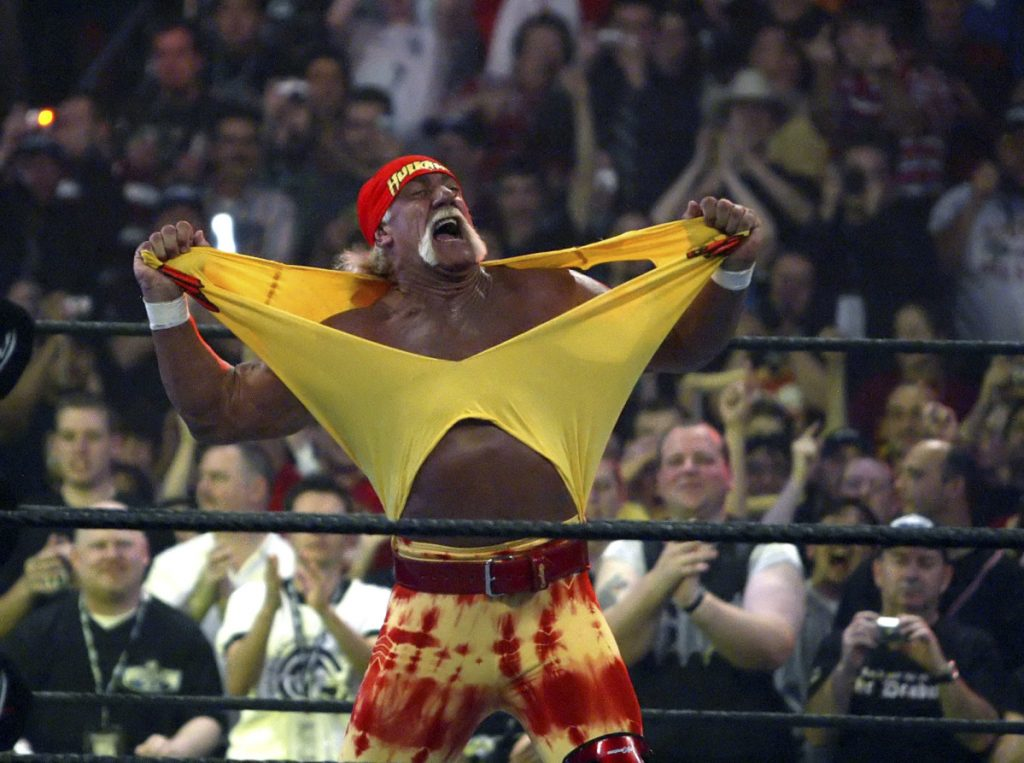 In this April 3, 2005 photo, Hulk Hogan fires up the crowd between matches during WrestleMania 21 in Los Angeles. In an ever-changing world, professional wrestling's signature event provides a needed constant, Dave Dyer writes.