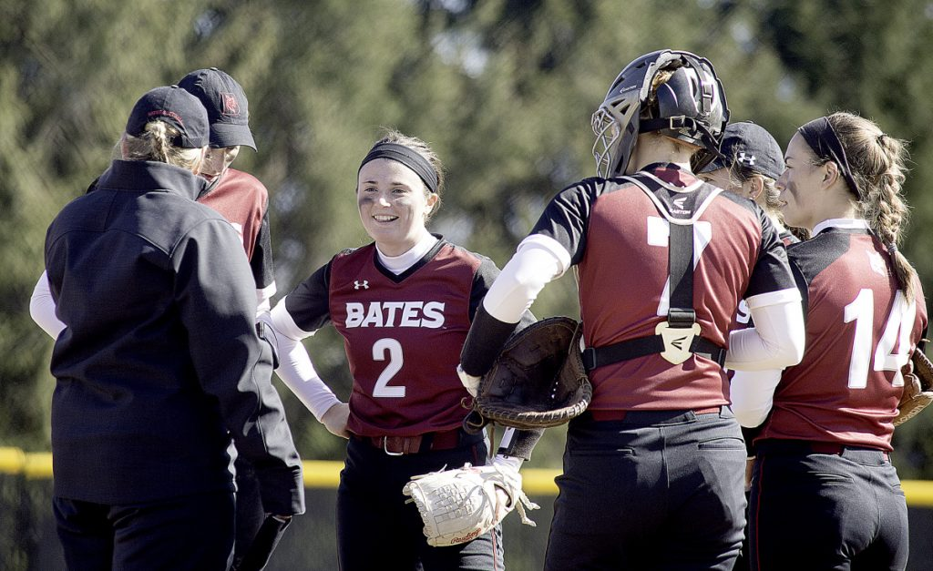 Sun Journal photo by Daryn Slover   Bates College pitcher Kirsten Pelletier (2) talks with her coach and teammates during Saturday's doubleheader against Tufts in Lewiston.