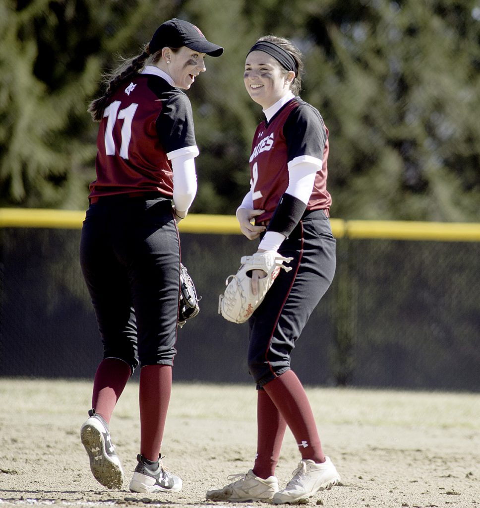 Sun Journal photo by Daryn Slover   Bates College pitcher Kirsten Pelletier, right, talks with shortstop Tori Fitzgerald during the first game of Saturday's doubleheader against Tufts in Lewiston.