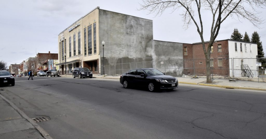 Colby College plans to buy the Camden National Bank building in downtown Waterville and demolish it to make room for a hotel development next door on the former Levine's store site.