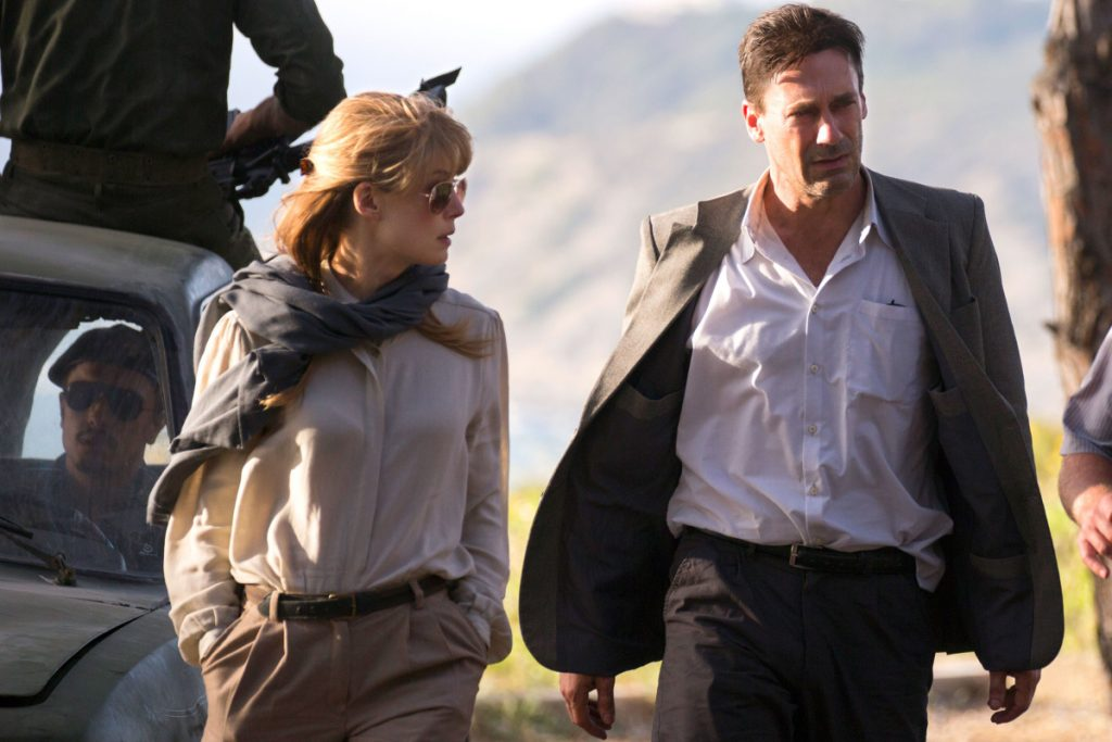 "Rosamund Pike, left, stars as Sandy Crowder, Jon Hamm, right, as Mason Skiles and Dean Norris, not pictured, as Donald Gaines in ""Beirut."""