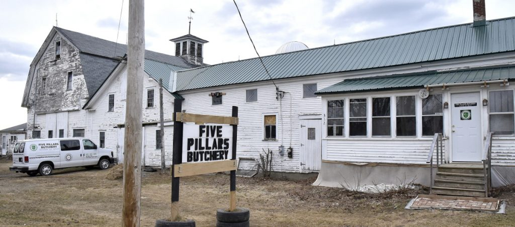 A sign outside the Five Pillars Butchery farm on the Detroit Road in Troy, seen Wednesday, has been repaired. Someone shot and damaged the sign Sunday, but Hussam Alrawi fixed it after police investigated, saying he wants to send a message that he and his family are in Troy to stay.