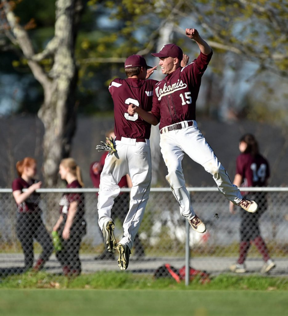 Staff photo by Michael G. Seamans   Nokomis pitcher Josh Perry, right, celebrates a three-hit shutout over Erskine with teammate Josh Smestod last season in South China.