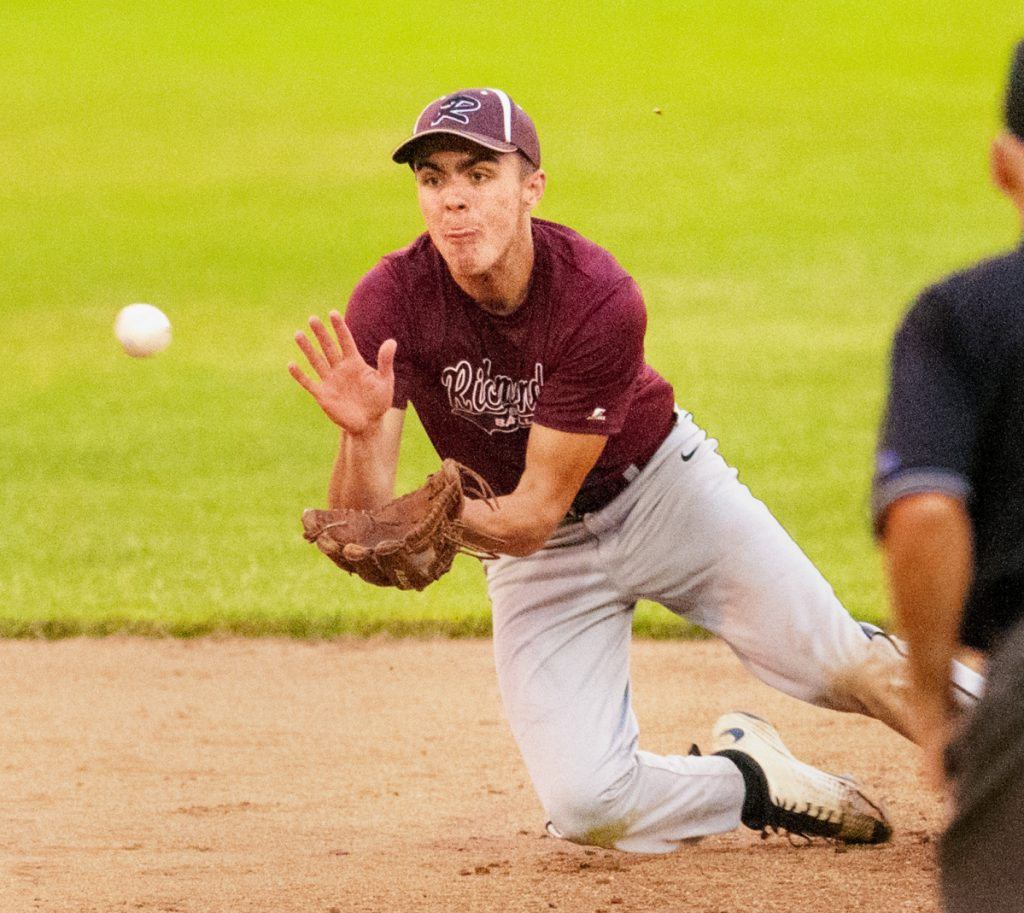 Staying focused: Richmond shortstop Zach Small dives for the ball during a game gainst Searsport in the Class D South regional final last season at St. Joseph's College in Standish.