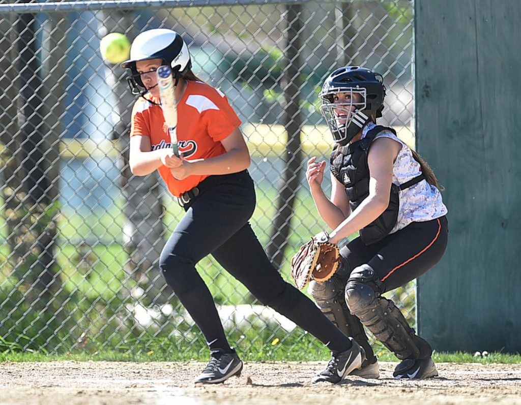 Full contact: Gardiner's Kylie Sirois connects on a pitch from Winslow's Broghan Gagnon during a game last season in Winslow.