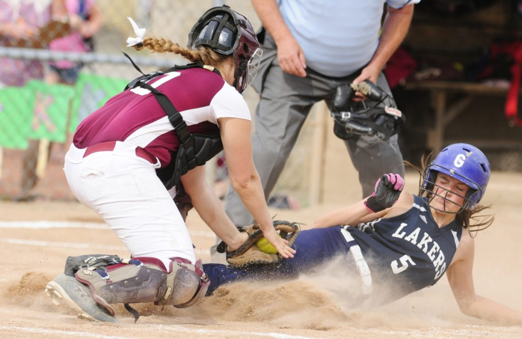 Richmond catcher Sydney Tilton, left, tags Greenville's Aleya Pelletier during the Class D South regional final last season at St. Joseph's College in Standish.