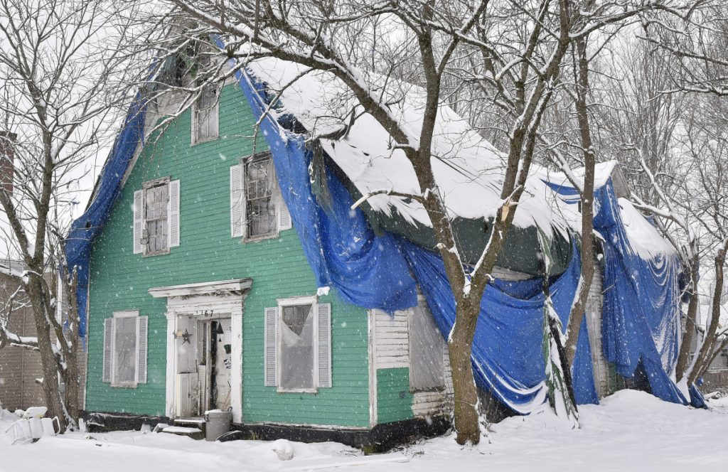 Charles McIntyre, owner of this home shown Jan. 17 on Main Street in Clinton, has appealed the town's order to demolish the building, and the town has asked the court to dismiss the appeal.