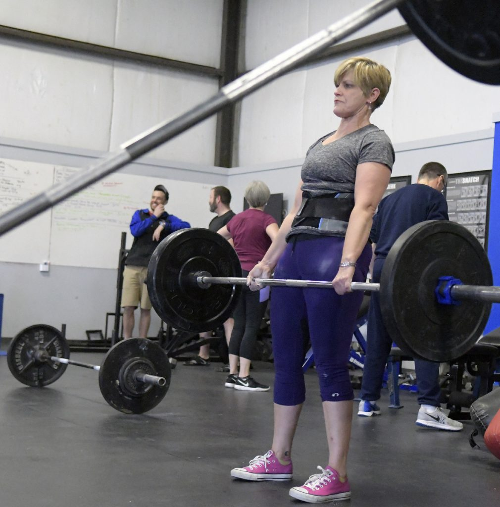 Denise Pouliot deadlifts at GEvolution Fitness Wednesday in Augusta ahead of of the Central Maine Strongman Competition on Saturday.