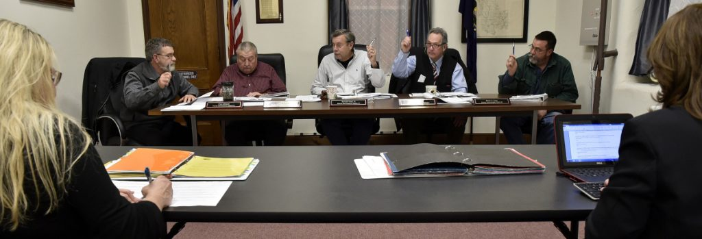 Somerset County Commissioners vote during a meeting in Skowhegan on Jan. 3, 2017. From left are Cyprien Johnson, Lloyd Trafton, Chairman Newell Graf Jr., Robert Sezak and Dean Cray. Commisioners will take up next year's budget proposal on Wednesday.