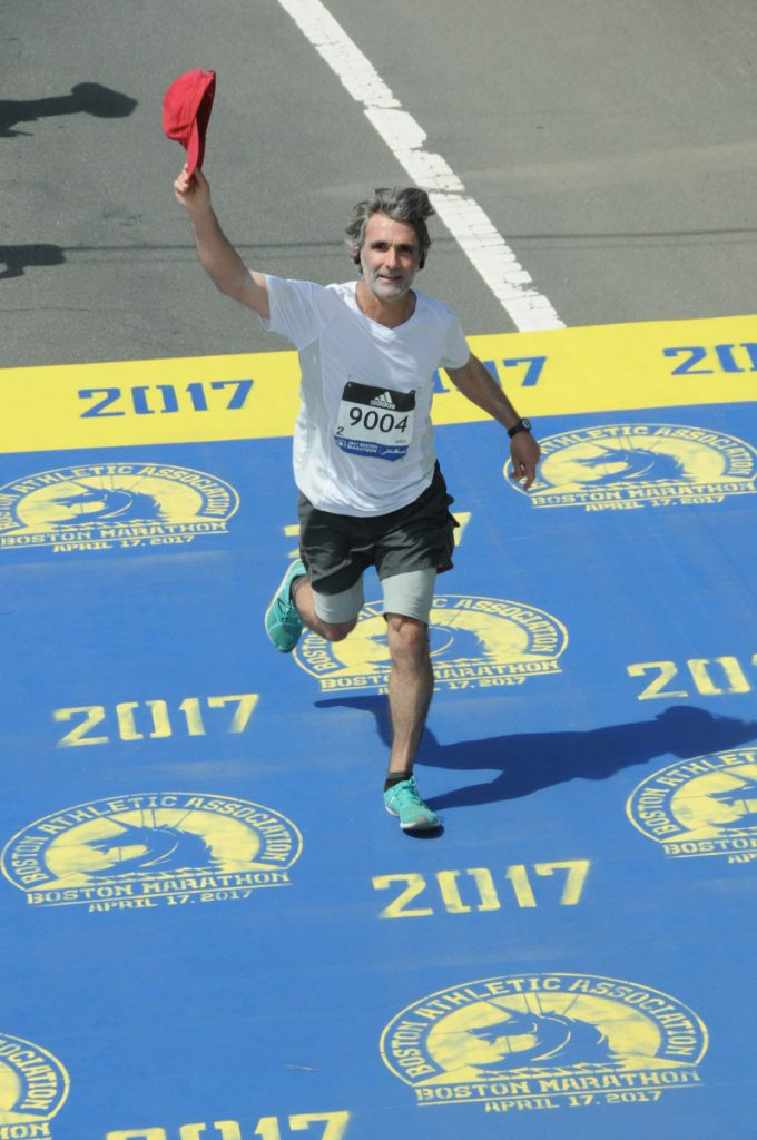 Alain Ollier, a substitute French teacher at Gardiner Area High School, completes the Boston Marathon last year. A native of Paris, France, now living in Newcastle in Maine's mid-coast, will make a second straight Boston Marathon start on Monday.