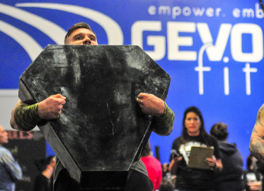 C.J. Viera carries the 100 pound metal box with two chains in it during the Men's Novice Husafell Carry on Saturday at the Central Maine Strongman contest in Augusta.