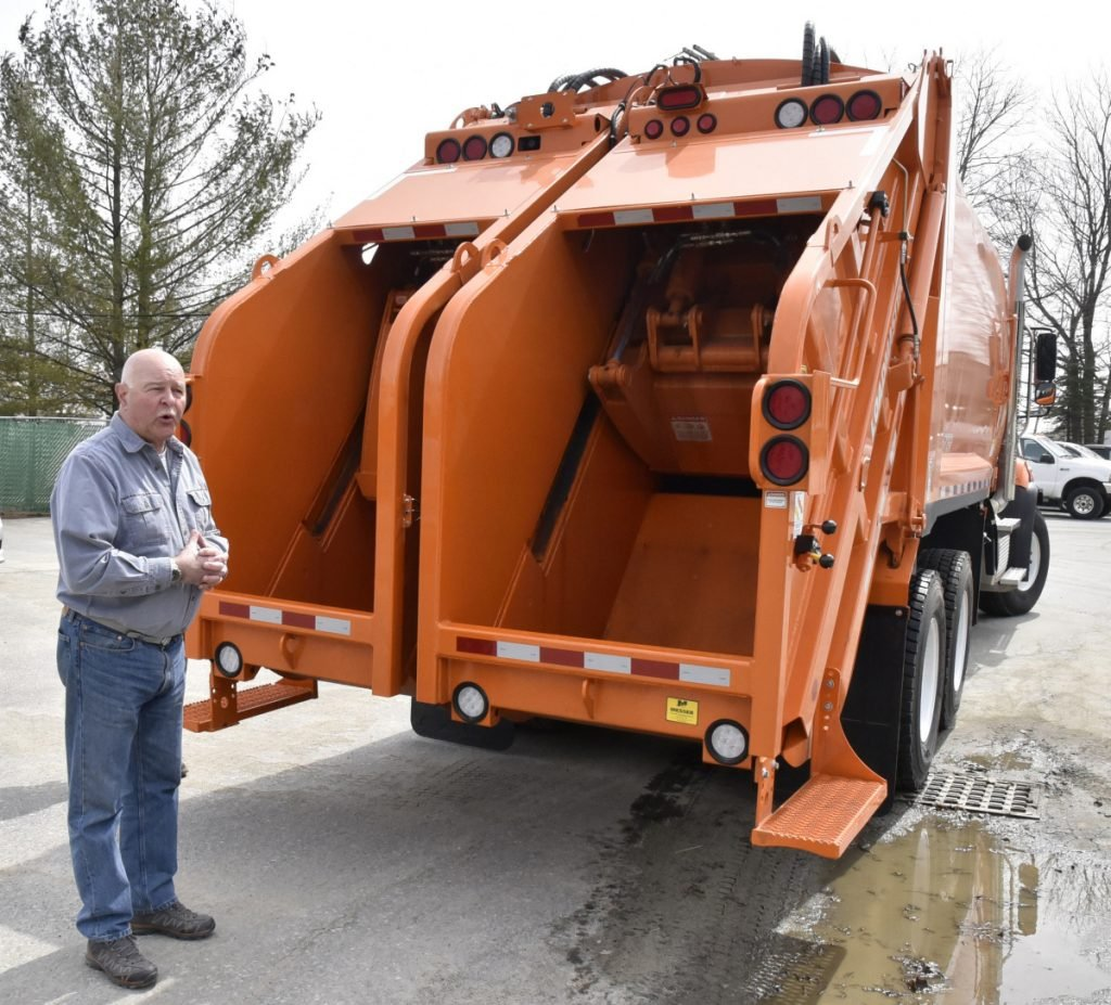 Mark Tuner, director of the Waterville Public Works department, talks about the new dual chamber packer truck that will be used to collect trash and recyclable materials in separate sections of the truck on Tuesday.