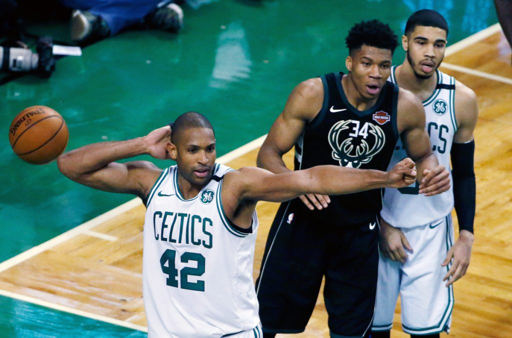 AP photo Boston's Al Horford (42) and Milwaukee's Giannis Antetokounmpo (34) react to a call during the fourth quarter of Game 1 of a first-round playoff series Sunday in Boston. The Celtics won 113-107 in overtime.