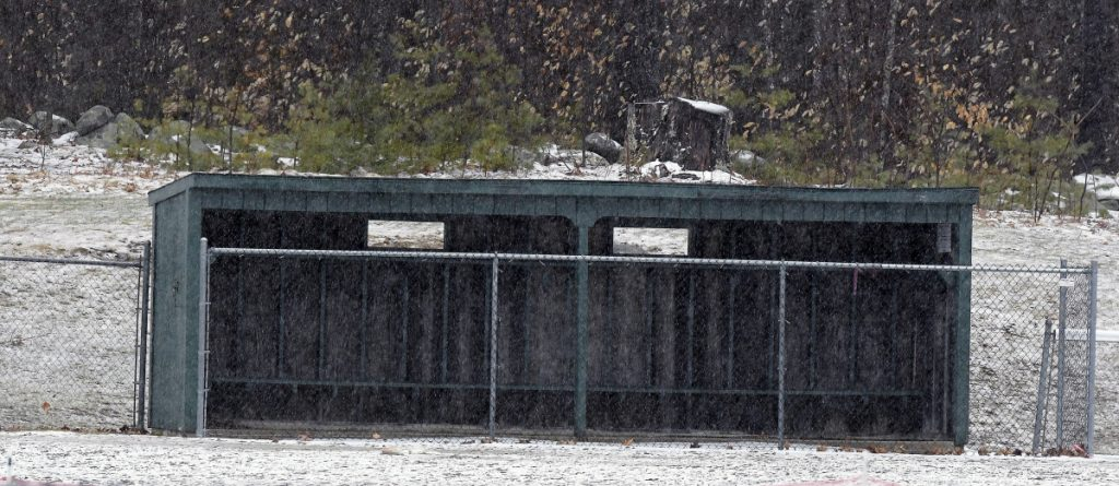 Staff photo by Andy Molloy   The Hall-Dale High School softball field, like most across the state, is covered in snow and ice Monday in Farmingdale.