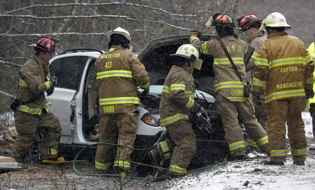 Firefighters and EMS workers extricate the driver of an SUV involved in a head-on collision Monday on Granite Hill Road in Manchester. The driver of the other vehicle fled the scene, according to Kennebec County Sheriff's Deputy Sgt. Mike Dutil, after the Pontiac he had been driving was disabled in the accident. The driver of the SUV was transported to a local hospital, Dutil said, and police were searching for the other driver.