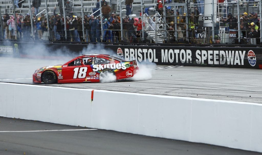 Kyle Busch does a burnout after winning during a NASCAR Cup Series race Monday in Bristol, Tennessee.
