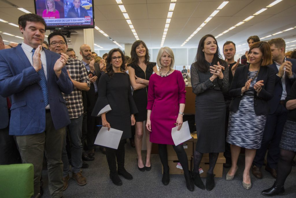 Rebecca Corbett, center in magenta dress, assistant managing editor of The New York Times and a former Morning Sentinel editor, stands amid Times staff Monday as they applaud the announcement that she and two reporters to her right, Megan Twohey and Jodi Kantor, have won the Pulitzer Prize for Public Service, chronicling the decades of sexual harassment perpetrated by Harvey Weinstein and other powerful men and helping to ignite the #MeToo movement.