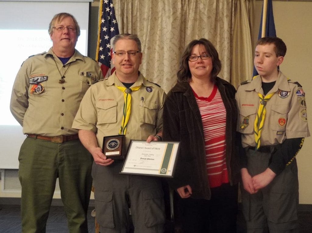 Joe Shelton received the District Award of Merit at the Boy Scout District Dinner on April 7 at the Waterville Lodge of Elks. From left are Kennebec Valley District Chairman Bruce Rueger, Joe Shelton, Terry Shelton and Nick Shelton. Joe was one of two to receive the highest honor a local district of Scouting can present to a volunteer leader. The second will be presented at a later date.
