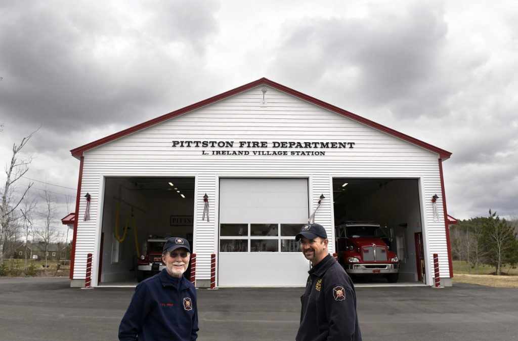 Larry Ireland, left, and Chief Jason Farris stand outside the new East Pittston Fire Station on Thursday. The building was named after Ireland, a longtime volunteer with the company.