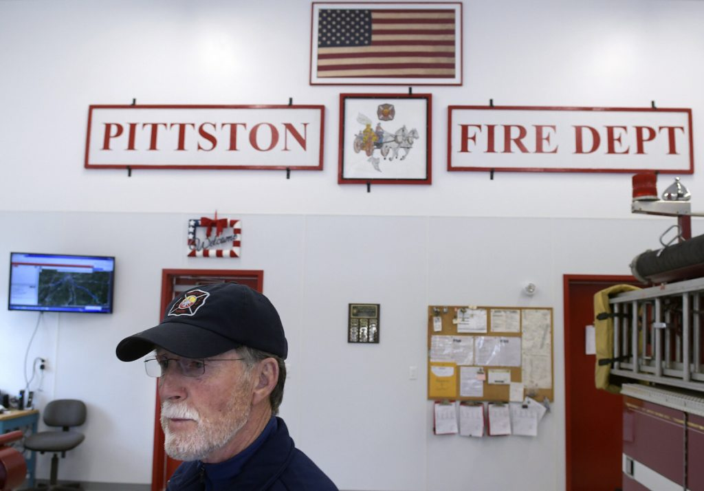 Larry Ireland walks through the new East Pittston Fire Station on Thursday. The building was named after Ireland, a longtime volunteer with the company.