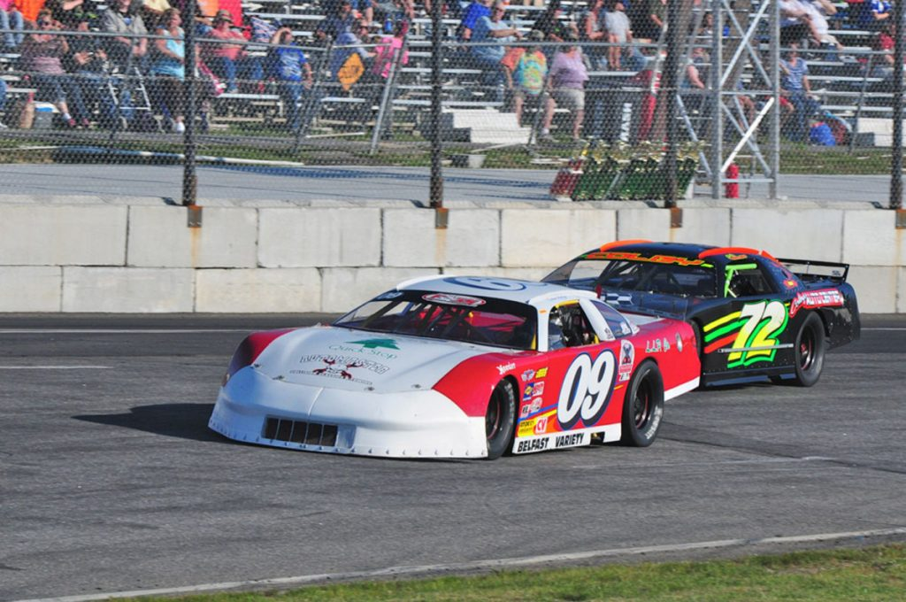 Daren Ripley (09) leads Charlie Colby into turn one during a Pro Stock feature last season at Wiscasset Speedway. Ripley overcame a 22-point deficit over the final two races of the season to win the 2017 track championship.