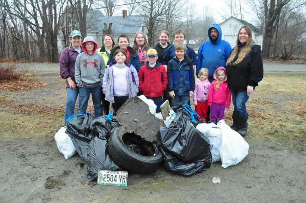 Members of New Sharon Girl Scout Troop 212 and friends and families collected several bags of trash along the town's roads on April 17, as an Earth Day project. The event was sponsored by the New Sharon Community Improvement Team. Front, from left, are Kaden Allen, Lily Ayer, Aiden Ayer, Joey Rackliff, Emmah-Jean Emery, Miah Emery and Jennifer Rackliff. Back, from left are Wendy Pond of the CIT, Karen Ayer, Nicholas Rackliff, Megan Rackliff, Lorna Ayer, Sam Rackliff and Warren Taylor.