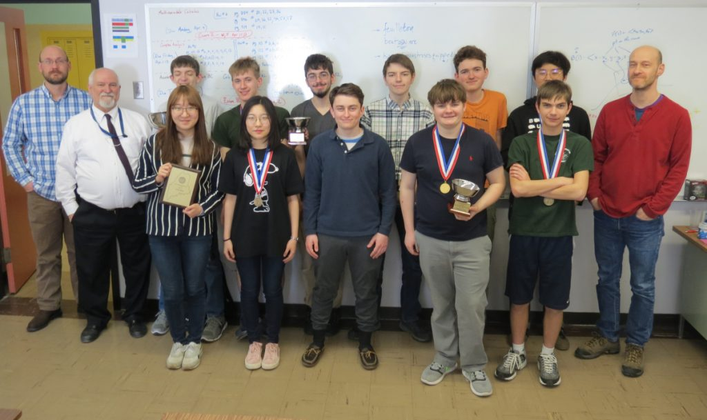 The Maine School of Science and Mathematics Math Team in front, from left are Math Department Chairman Pete Pedersen, Hyoju Kweon, Eunice Liu, Tobyn Blatt, James Hawkes and Jordan Theriault. In back, from left, are math instructor Todd Smith, Brett Foster, David Govoni, Wyatt Giroux, Ethan Winters, Wesley Chalmers, Jack Kang, math instructor Mark Rhodes.