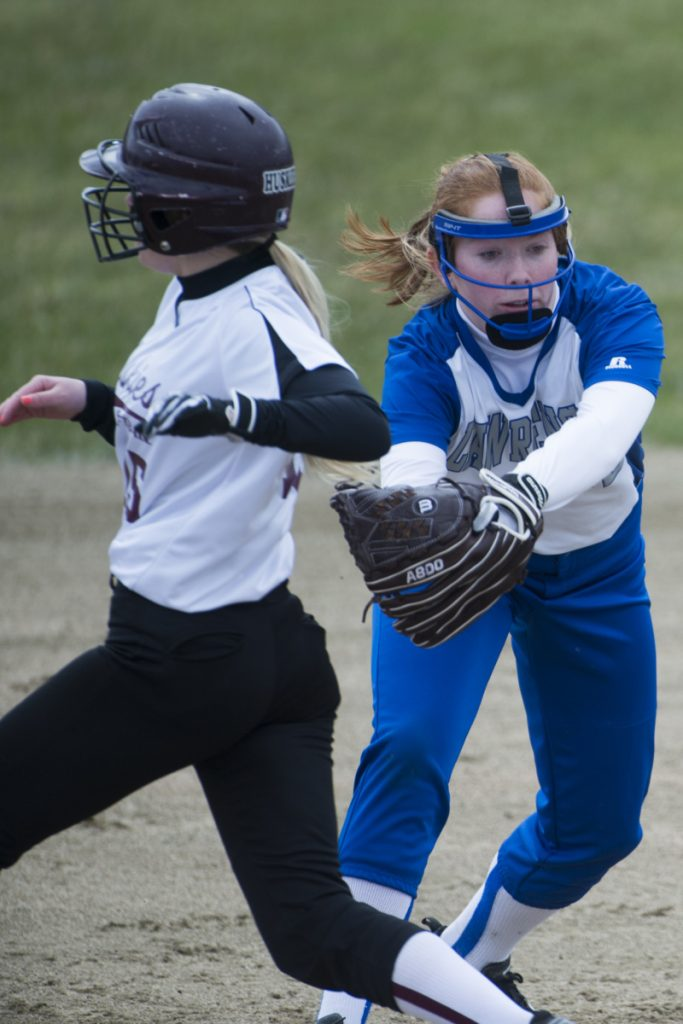 Maine Central Institute's Josie Libby, left, avoids the tag from Lawrence second baseman Sarah Poli on Friday in Fairfield.
