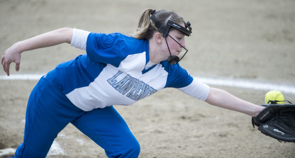 Lawrence pitcher Sam Marshall tries to field a hard hit ground ball by Maine Central Institute on Friday in Fairfield.
