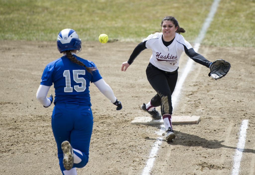 Lawrence's Molly Folsom (15) beats out the throw to Maine Central Institute first baseman Leah Bussell on Friday in Fairfield.