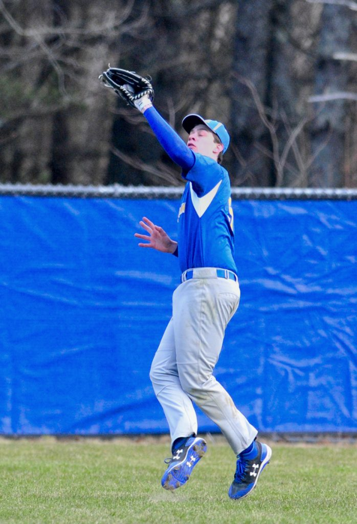 Mt. Abram center field Jack Deming catches a pop fly against Oak Hill on Friday in Wales.