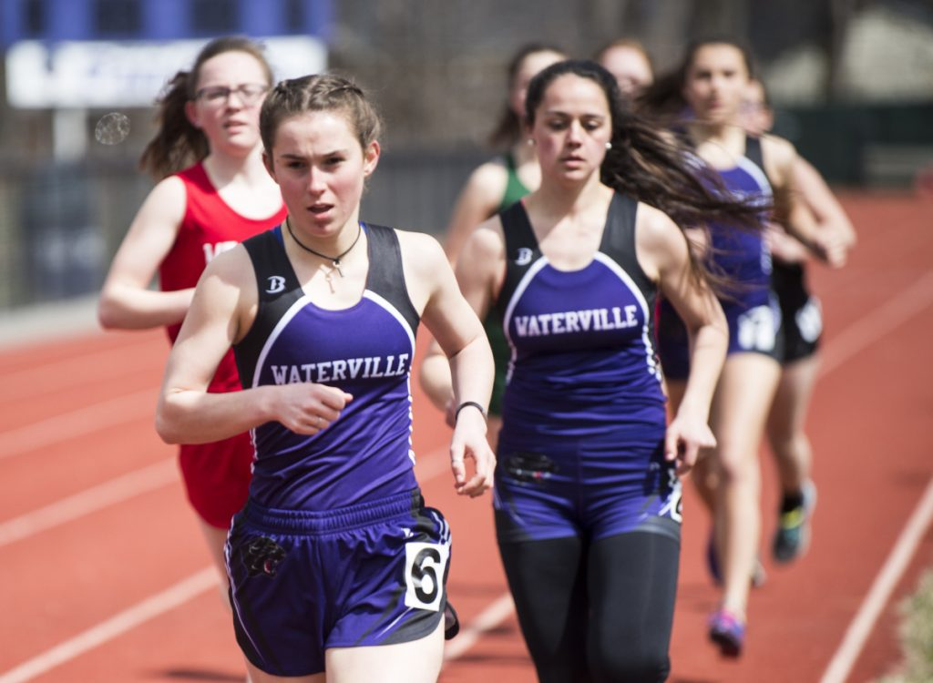 Waterville's Gwinna Remillard, foreground, competes in the 1,600 meters with teammate Rebecca Beringer, back right, at the Waterville Relays on Saturday in Waterville.
