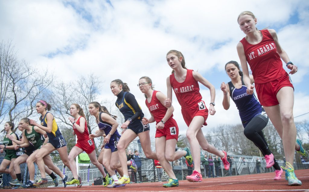 Runners from several high schools leave the starting line for the 1,600-meter run at the Waterville Relays on Saturday in Waterville.